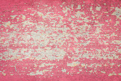Flaking Red Paint on Faded Wood Background. Royalty Free Stock Images