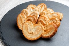Flaky biscuits eyelet on the slate Board.  royalty free stock photo