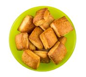 Flaky biscuits in green bowl  on white background Stock Photo