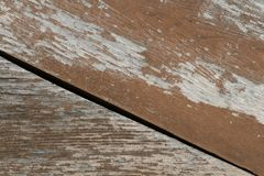 Flaky brown paint on the old wooden surface of the Board royalty free stock images