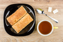 Flaky cookies in plate, tea, spoon and lumpy sugar Royalty Free Stock Photo