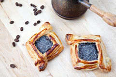 Flaky croissant with coffee. Freshly baked flaky croissant with poppy and coffee beans Stock Images