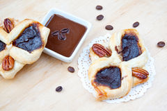 Flaky croissant with coffee. Tow flaky croissant with coffee and chokolade cream Royalty Free Stock Photos