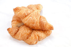 Flaky croissants on white background. Royalty Free Stock Image