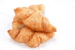 Flaky croissants on white background. Royalty Free Stock Image