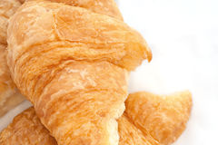 Flaky croissants on white background. Royalty Free Stock Photos