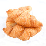 Flaky croissants on white background. Stock Photo