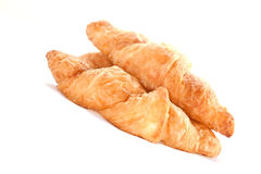 Flaky croissants on white background. Stock Images
