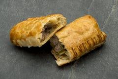 Flaky Dough Pocket Meat Pie Halves. On a stone countertop Royalty Free Stock Photos