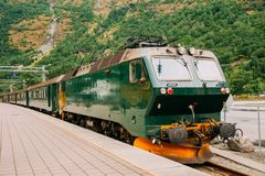 Flam, Norway. Famous Railroad Flamsbahn. Green Norwegian Train Near Railway Station Stock Photo