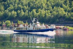 People enjoy tour by ferry boat at the Aurlandsfjord in Flam, Norway. royalty free stock photo