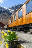Flam Railway Wooden Railcar with Mountains and Fjords in Background royalty free stock images