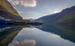 Flam village with water reflection of the ford. Flam, NorwaynFlåm is a village in Flåmsdalen, at the inner end of the Aurlandsfjorden—a branch of Stock Image