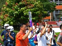 Flama dos Jogos Olímpicos 2010 da juventude de Singpaore! Fotografia de Stock Royalty Free