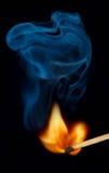 Flama e fumo de fósforo Fotos de Stock Royalty Free