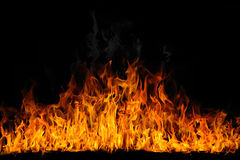 Flama isolada no preto Imagens de Stock Royalty Free
