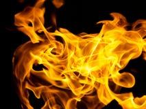 Flamas do incêndio em um fundo preto Foto de Stock