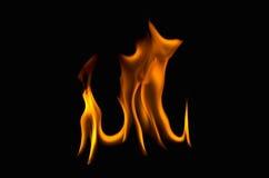 Flamas do incêndio em um fundo preto Fotos de Stock