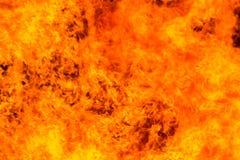 Flamas do incêndio em um fundo preto Fotografia de Stock