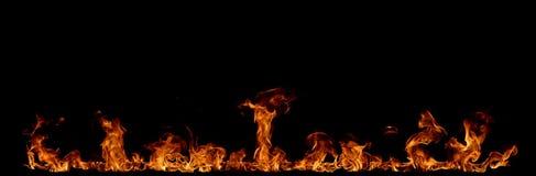Flamas do incêndio no fundo preto Fotografia de Stock Royalty Free