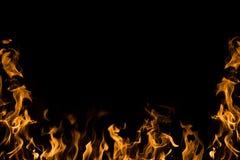 Flamas do incêndio no fundo preto Fotos de Stock