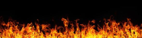 Flamas do incêndio no fundo preto Imagens de Stock