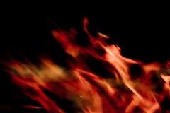 Flamas no fundo preto Imagens de Stock