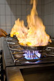 Flambe. Chef is prepering a flambe dish Stock Image