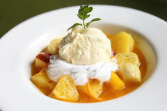 Flambe banana orange and apple with ice cream Royalty Free Stock Photo