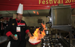 Flambe. The cook was showing how to cook with flambe technique in Solo, Central Java, Indonesia Stock Photos
