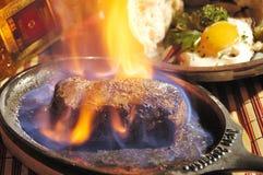 Flambe de bifteck Images libres de droits