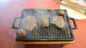 Flambe Meat on Pan In The Restaurant stock footage