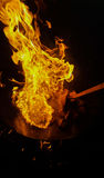 Flambe steak. On an iron disk Royalty Free Stock Photo