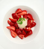 Flambe strawberries with ice cream Stock Photo