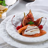 Flambed pancakes with figs and cherries  Stock Images