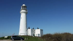 Flamborough Head Lighthouse - Yorkshire - England. Flamborough Head Lighthouse on the northeast coast of England stock footage