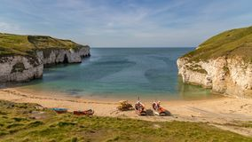 Flamborough North Landing, East Riding of Yorkshire, UK. Fishing boats and crawler on the beach of Flamborough North Landing near Bridlington, East Riding of royalty free stock photos