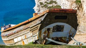 Flamborough North Landing, East Riding of Yorkshire, UK. Old boat, seen at Flamborough North Landing, near Bridlington, East Riding of Yorkshire, UK royalty free stock photography