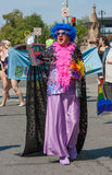 Flamboyant Man Waving in Pride Parade Stock Images