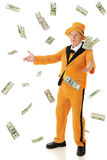 Flamboyant Senior. A flamboyant senior man wearing an orange tuxedo and hat, tossing or catching falling100, 50 and 20 dollar bills.  On a white background Stock Photo