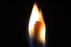 Flame. Close up of the flame of a burning matchstick Stock Image