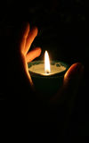 Flame. Female human hand clasped candle Royalty Free Stock Image