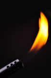 Flame. Closeup of a blow torch in a black background Stock Photography