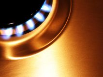 Flame 4. Landscape photo of single oven hob gas burner cropped to corner royalty free stock image