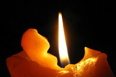 Flame. Complex wax figure of burning candle Royalty Free Stock Images