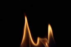 Flame. Isolated against a black background Stock Photos