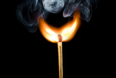 Flame. Burning match on the black bakcground Royalty Free Stock Photos