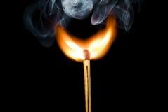 Flame. Burning match on the black bakcground royalty free stock photos