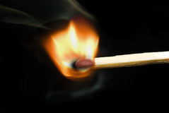 Flame. Burning match on the black background Royalty Free Stock Photos