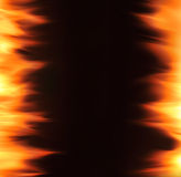 Flame. Against a black background Royalty Free Stock Photo